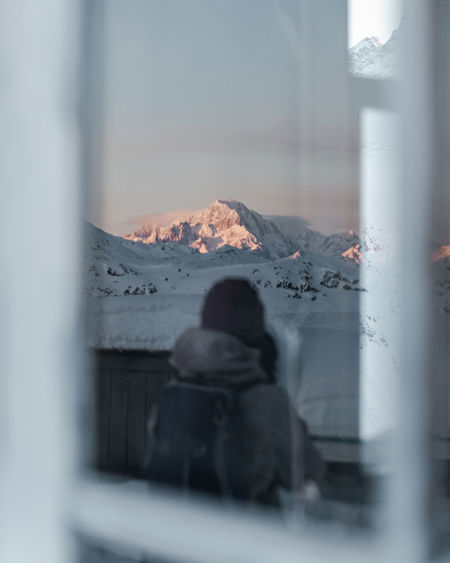 Rear view of people on glass window