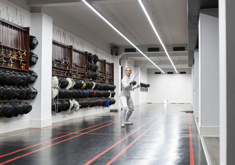 Side view of man walking in corridor of building