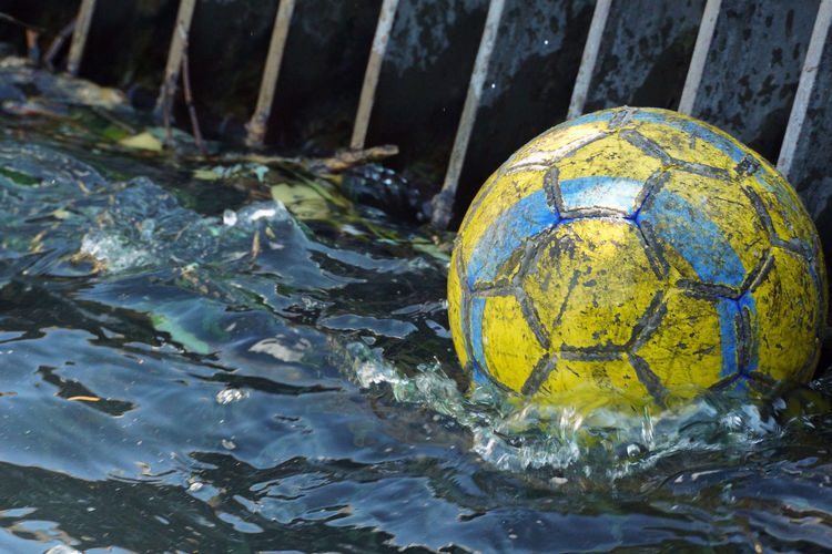 Close-up of soccer ball floating in lake