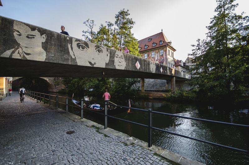 Architecture Bridge Bridge - Man Made Structure Building Exterior Built Structure Connection Day Footbridge Lifestyles Nature Outdoors People Plant Railing Real People River Sky Transportation Tree Water