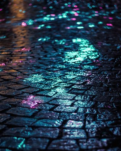 Wet street shining at night