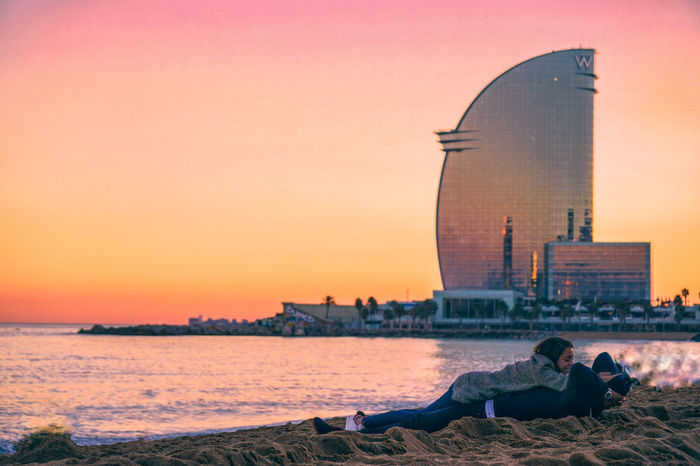 Lovely couple in La Barceloneta Beach, Barcelona, Spain. La Barceloneta Catalunya Catalonia Barcelona SPAIN Spain🇪🇸 W Hotel Couple Beach Love Cuddle Sand España🇪🇸 Europe Europe Trip Water Shore Shoreline Sunset Hotel Golden Golden Hour Architecture People Winter Nature City Outdoors Cityscape Day