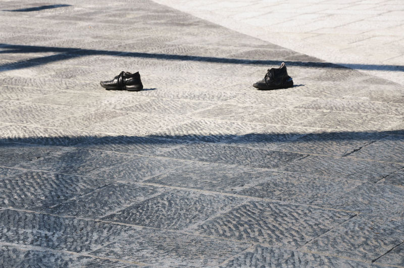 Abandoned shoes. Scarpe abbandonate. Patern Pieces Backgrounds Taking Photos Abandoned Composition Day Eye4photography  EyeEm Gallery Learn & Shoot: Balancing Elements Learn & Shoot: Simplicity Leisure Activity Lifestyles Light And Shadow Outdoors Pattern Photography Road Shadow Shoes Showcase March Still Life Street Street Photography Streetphotography Sunlight