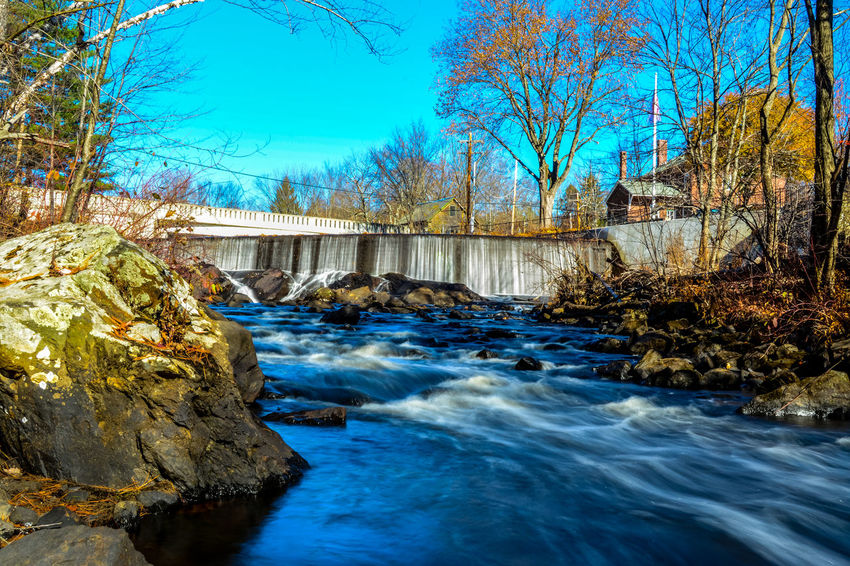 Long exposure shot of Groton bridge and dam in Groton, MA Cold Cold Temperature Color Dam Fall Flowing Flowing Water Groton Lake Long Exposure Motion Narrow Nature Outdoors Reflection Rippled River Rock Rock - Object Splashing Tranquil Scene Water Waterfall Waterfront Winter
