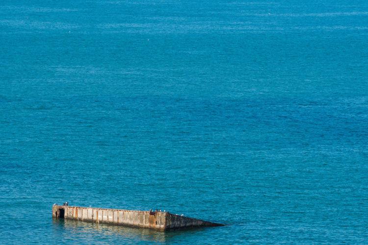 High angle view of abandoned blue sea