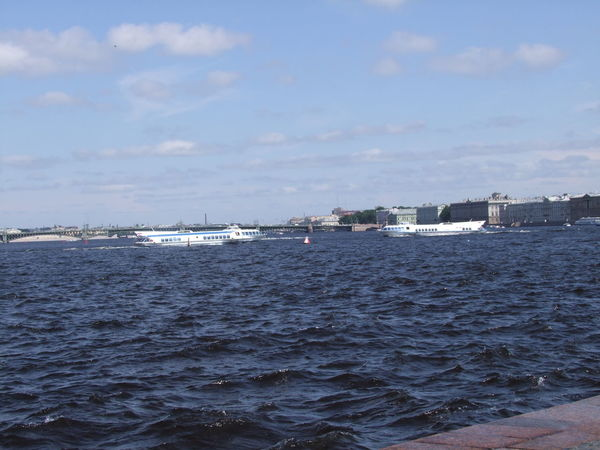 Hydrofoyle on Baltic Sea Baltic Sea Blue Sky White Clouds Building Exterior City Day Distant Ferry Harbor Hydrofoyle Mode Of Transport Nautical Vessel Outdoors Rippled Russia Saint Petersburg Sea Sea And Sky Ship Tourist Attraction  Transportation Water Water Reflections Waterfront