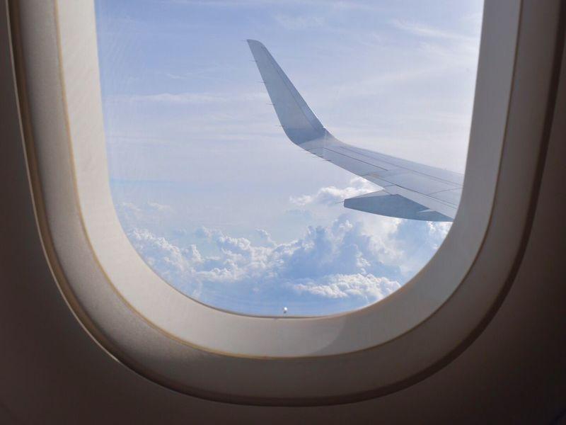 Flight Wings Flight Window Clouds Through Flight Window