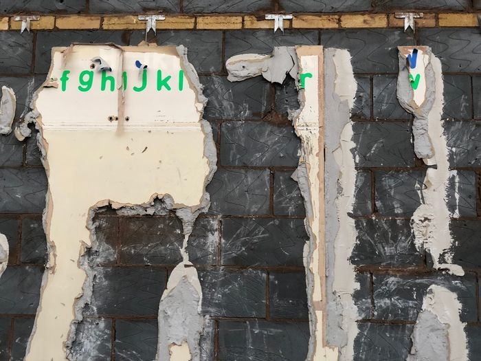 Demolition Alphabet Wall - Building Feature Built Structure Text Architecture No People Communication Day Building Exterior Western Script Old Outdoors Wall Weathered Sign Full Frame Textured  Close-up