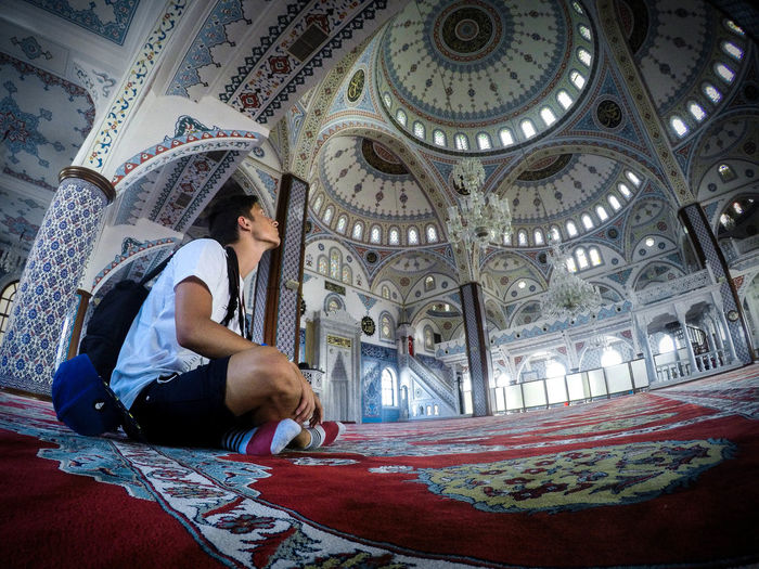 Djhamida Dzsámi Adult Adults Only Architecture Casual Clothing Day Full Length Indoors  Low Angle View One Person People Real People Sitting Temple Young Adult