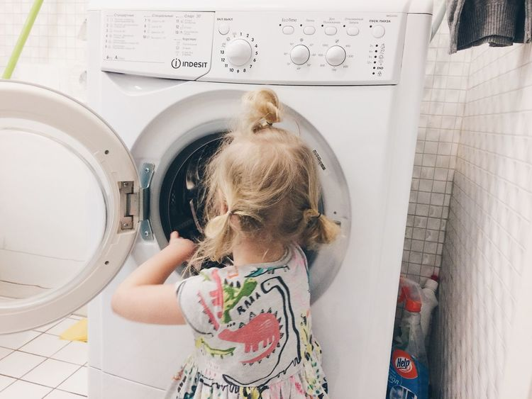 Adult Blond Hair Childhood Day Domestic Life Indoors  Laundry Machinery One Girl Only One Person People Washing Machine