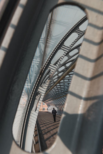 High angle view of person walking through a tunnel