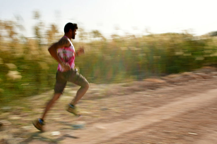 running man in the country side Country Living Country Road Earth Running Running Shoes Blurred Motion Country Life Countryside Day Earth Road Leisure Activity Lifestyles Motion Nature One Person Outdoors People Practicing Real People Running Running Time Running Track Runningman Young Adult Young Man