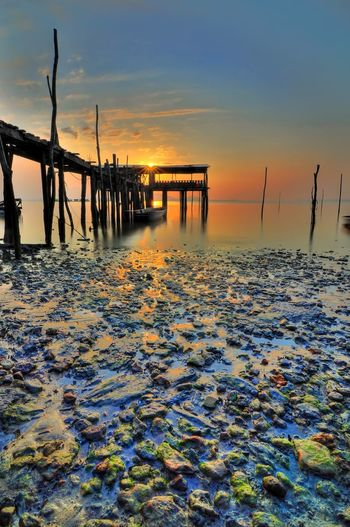 majestic sunrise at Fishermen village Sunrise Thailand Malaysia Fisherman Wooden Wooden Jetty Jetty Hub Hut Silhouette Muddy Moss Nature Water Sea Sunset Beach Low Tide Nautical Vessel Horizon Fishing Reflection Multi Colored Seascape Coastline Coastal Feature Tide Fishing Industry Ocean Rocky Coastline