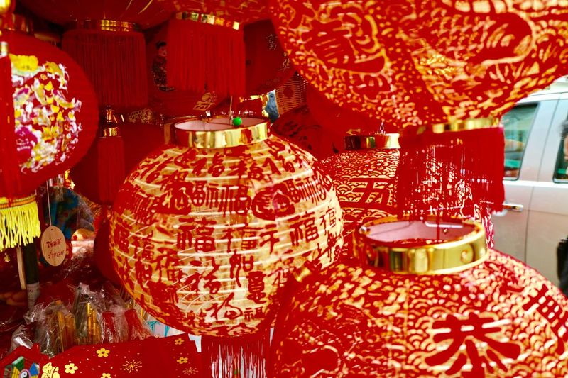 Red paper lanterns for Chinese New Year Season Cultures Chinese New Year Decoration Chinese Lantern Lighting Equipment Illuminated Red Chinese Lantern Festival Hanging Lantern Traditional Festival Celebration Non-western Script Chinatown Indoors  No People Paper Lantern Close-up