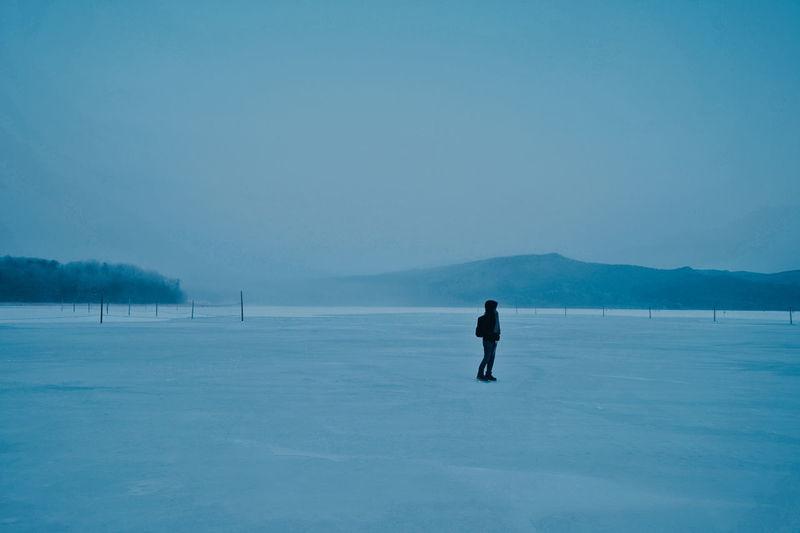 Full length of man on snow against sky