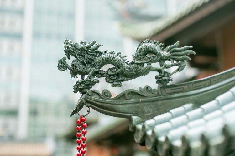 Close-Up Of Chinese Dragon Statue On Temple Roof