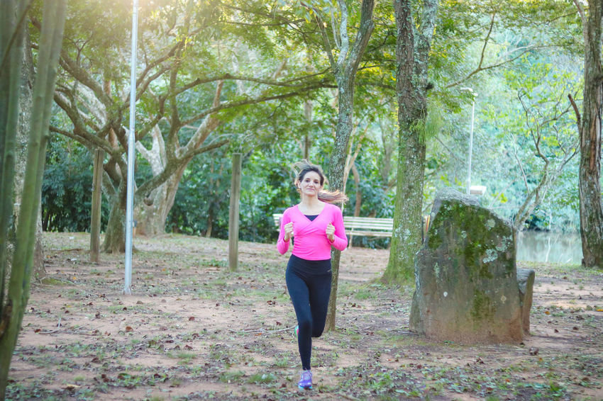 Adult Adults Only Day Exercising Forest Full Length Healthy Lifestyle Jogging Lifestyles Mid Adult Mid Adult Women Nature One Person One Woman Only Only Women Outdoors People Self Improvement Sports Clothing Standing Tree Vitality Wellbeing Women