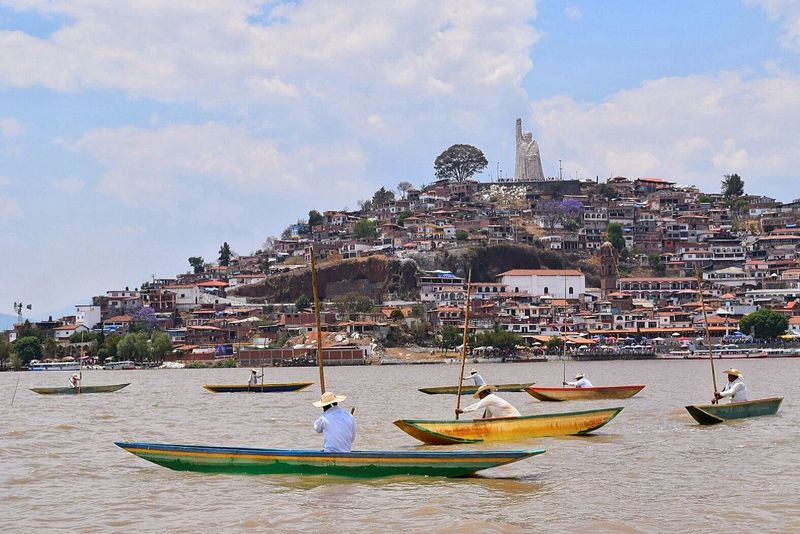 Fishermen in Janitzio, Mexico Beauty In Nature Boats Built Structure Cloud - Sky Day Fishing Fishing Boat Fishing Village Island Lake Men Mexico Michoacan, México Nautical Vessel Outdoors People Real People Sky Town Tradition Water