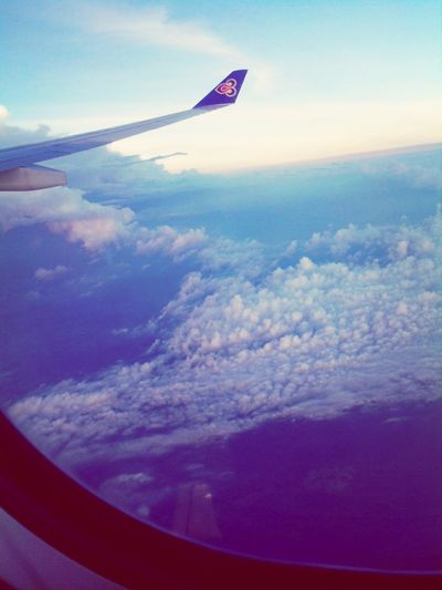 From An Airplane Window Clouds And Sky Traveling Thai Airways My View Dusk Sky Having A Good Time Singapore To Bangkok