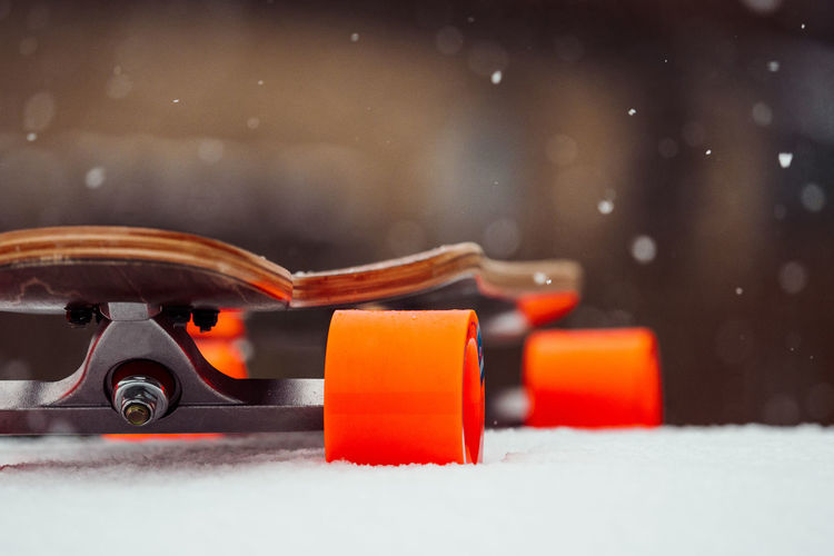 BAD CONDITIONS Mobility In Mega Cities Longboard Skateboarding Winter Wintertime Close-up Day Focus On Foreground No People Orange Color Outdoors Skateboard Snow Shades Of Winter The Great Outdoors - 2018 EyeEm Awards Skate Photography: Same Tricks, New Perspectives