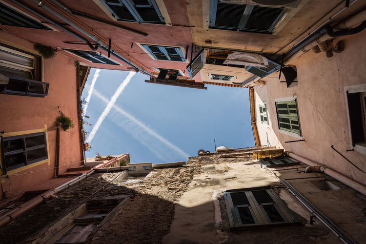 the sky above sanremo Architecture Built Structure Building Exterior Window Building Residential District Low Angle View Day No People Old Sunlight Abandoned Nature Damaged House Outdoors History Sky Run-down City Ruined Apartment Directly Below