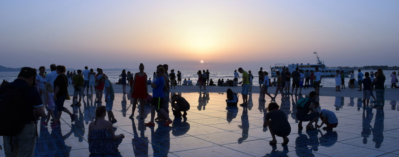 Clear Sky Large Group Of People Reflection Sea Sky Sun Sunset Tourism Travel Destinations