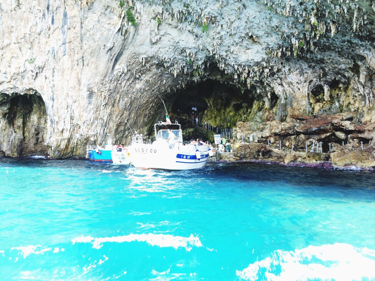 rock - object, rock formation, water, day, cave, transportation, nature, nautical vessel, real people, outdoors, beauty in nature