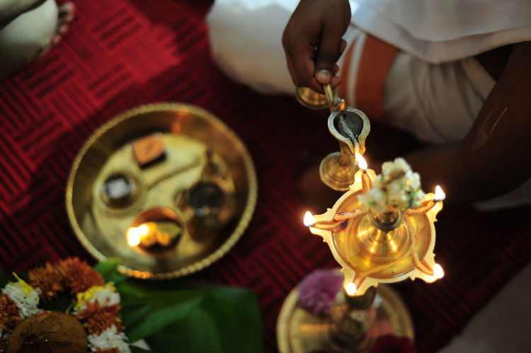 Indian Wedding Wedding Bowl Burning Candle Close-up Diya - Oil Lamp Flame Flower High Angle View Human Hand Indian Celebration 🎉 Indoors  Low Section Oil Lamp One Person People Place Of Worship Religion Spirituality Table Tradition