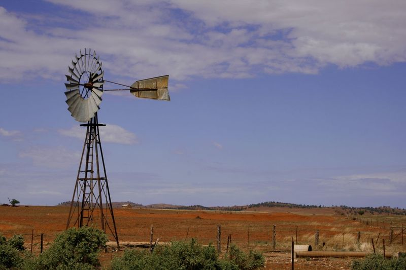 A wind driven water pump in the desert landscape of the Flinders Ranges South Australia Australian Landscape Desert Flinders Ranges Travel Photography Alternative Energy Arid Climate Arid Landscape Cloud - Sky Day Environmental Conservation Field Fuel And Power Generation Landscape Nature No People Outdoors Renewable Energy Rural Scene Sky Technology Water Pump Water Vane Wind Power