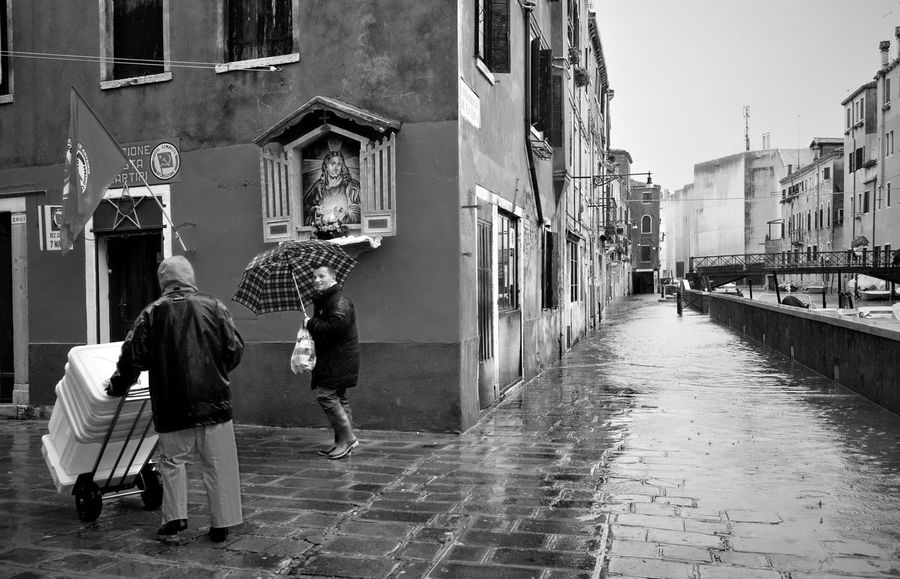 Italy, Venice, Grand Canal, Piazza San Marco, the flood, the Cathedral of San Marco Architecture Building Building Exterior Built Structure City City Life Cobblestone Diminishing Perspective Incidental People Leading Men Narrow Residential Structure Sidewalk Street The Way Forward Urban Walking