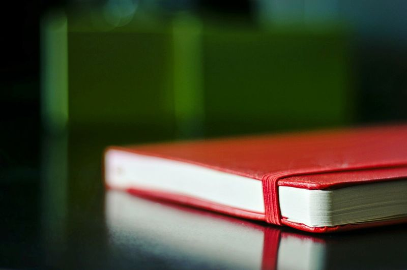 Close-up of diary on table