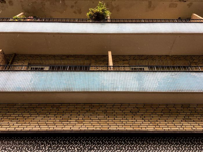 Sections Day Outdoors Building Building Exterior Balconies Tiled Tiles Different Materials Low Angle View Façade Architecture Sections Clear Lines