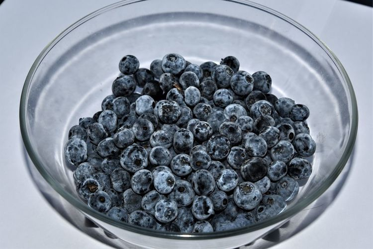 Blueberries in a Glass Bowl Abundance Berry Fruit Black Color Blue Blueberry Bowl Breakfast Close-up Food Freshness Fruit Healthy Eating Indoors  Large Group Of Objects Nature No People Still Life Studio Shot Wellbeing