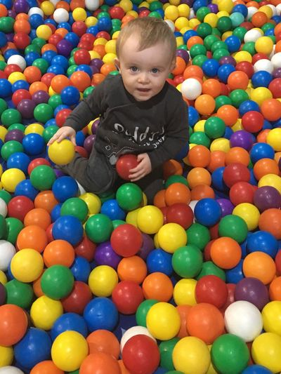 EyeEm Best Shots Popular Photos Colour Of Life Childhood Multi Colored One Person Front View Large Group Of Objects Full Length Baby Food Babies Only Happiness Portrait Real People Indoors  Day Ball People Ballpitt Twin Boy Jamie in soft play 😊
