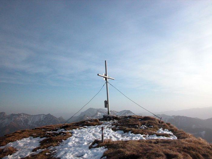 Windmill on mountain against sky