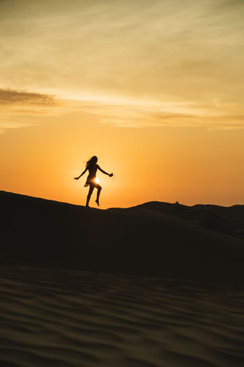 Sunset Land Real People Scenics - Nature Beauty In Nature Lifestyles Tranquility Leisure Activity Silhouette Nature Tranquil Scene Outdoors Orange Color Sky Desert Ica Peru Peruvian Pisco Woman