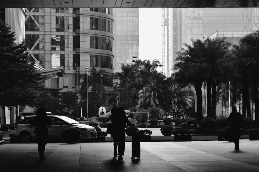 Bnw_friday_eyeemchallenge City Tree Full Length Men City Life Car Architecture Building Exterior Built Structure Financial District