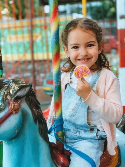 Portrait of a smiling girl in amusement park