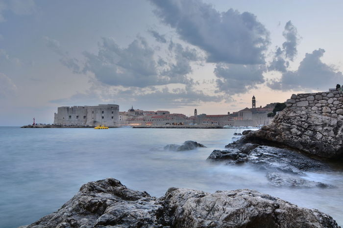 Blue hour. Old town view from Banje Beach. Dubrovnik. Croatia Blue Hour Croatia Dubrovnik, Croatia Mediterranean  Mediterranean Sea Old Town UNESCO World Heritage Site Adriatic Coast Adriatic Sea Architecture Banjebeach Beauty In Nature City Cloud - Sky Dubrovnik Europe Long Exposure No People Outdoors Rock - Object Sea Sunset Travel Destinations Water