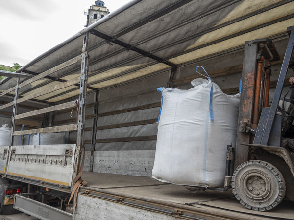 Loading big bags into the truck Big Bag Architecture Building Building Exterior Built Structure Day Freight Transportation Hanging Land Vehicle Loading Mode Of Transportation Nature No People Outdoors Rail Transportation Semi-truck Station Textile Train Transportation Travel Truck Wood - Material