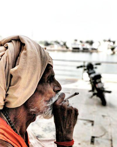Indian Sadhu on the ghats of Pushkar lake Oneplusphotography Ganja Hashgram Smoking Peace Carefree Bokeh Profile Turban Cannabis India Rajasthan One Person Focus On Foreground Headshot Smoking - Activity Marijuana - Herbal Cannabis Addiction Side View Adults Only