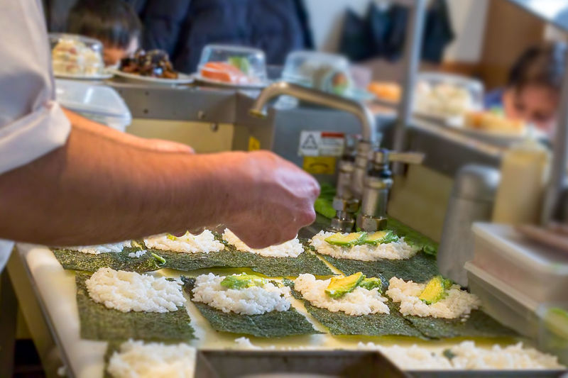 Rice Seaweed Sushi Avocado Chef Food Food And Drink Freshness Hand Human Body Part Human Hand Indoors  Kitchen Making Sushi Men Occupation Preparation  Preparing Food Real People Salmon Selective Focus Sushi Chef Uramaki Working