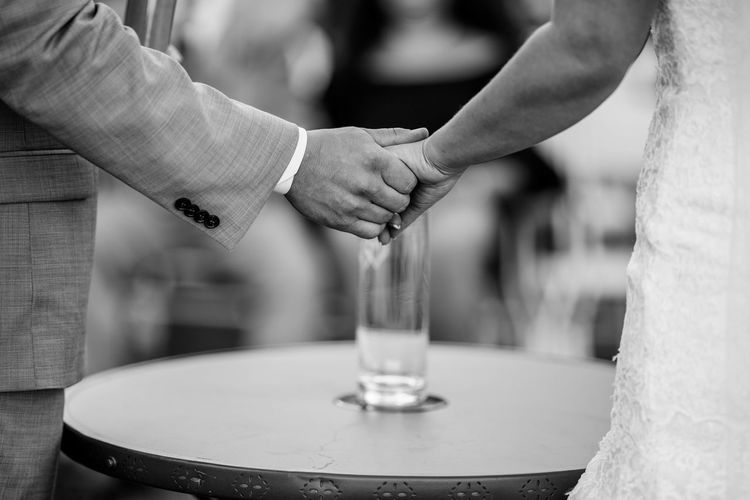 Cropped Image Of Newly Married Couple Holding Hands