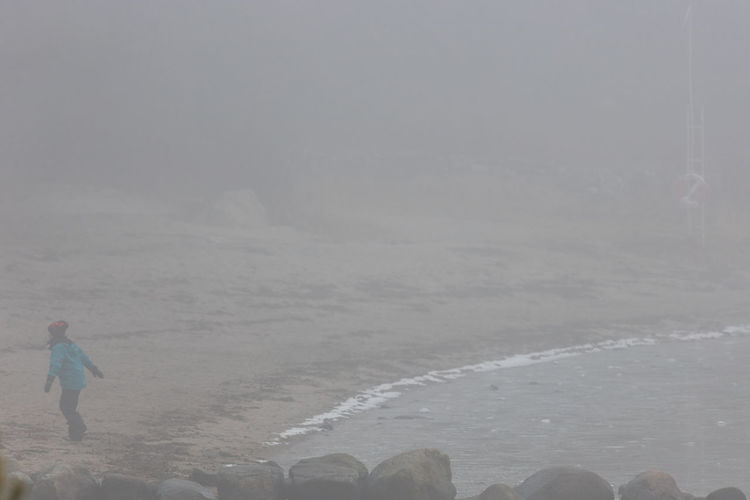 Adventure Beach Cold Temperature Day Fog Nature Nature One Person Outdoors Play Playful Playtime Real People Seaside Sweden Winter