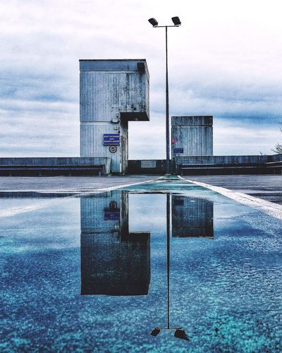 Urban typho Symmetry Mobilephotography TeamHuawei HuaweiP9 Portsmouth Mobile Photography Huaweiphotography Greatbritain Neverstopexploring  Symmetryporn Symmetricalmonsters Puddleography Puddle Reflections Water Sky Reflection Cloud - Sky Outdoors No People Road Sign