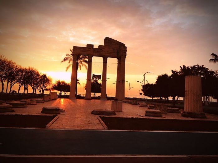 Türkiye Mersin EyeEm Nature Lover Sky Sunset Architecture Nature Tree Built Structure Plant Cloud - Sky Silhouette Travel Destinations No People Orange Color History The Past Water Outdoors Building Exterior Travel Sunlight Architectural Column 17.62° My Best Photo