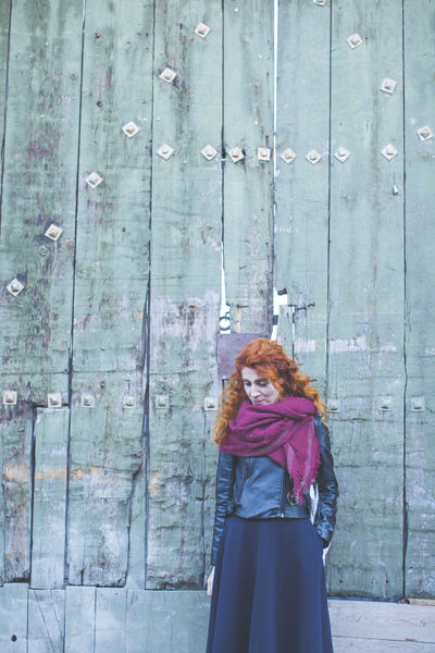 Alone Casual Clothing Casual Look Curly Curly Hair Green Color Long Hair Old Door Red Hair Shabby Standing Standing Alone Urban Wall Young Women The Portraitist - 2016 EyeEm Awards