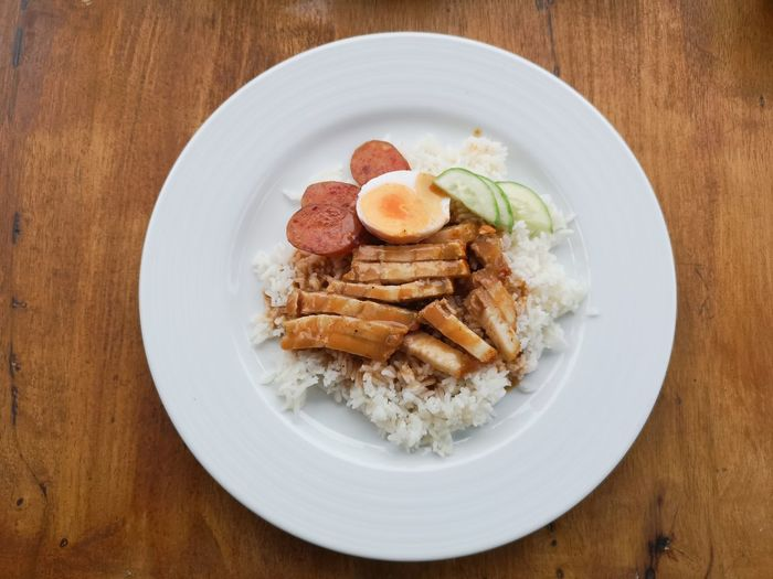Rice with crispy pork Meal Boiled Egg Comfortfood Bangkok Thailand. Breakfast Lunch Dinner Rice Crispy Pork Red Dish Spoon And Fork Food Thai Food EyeEm Selects Plate Ice Cream Comfort Food Meat Table Close-up