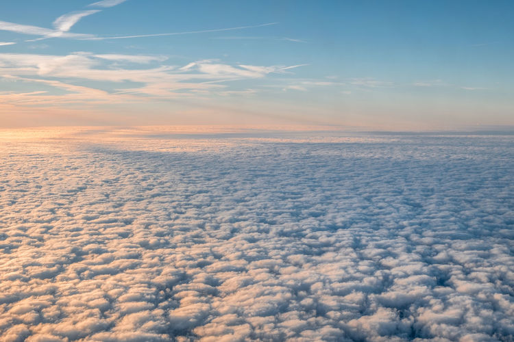 Cloud - Sky Sky Scenics - Nature Beauty In Nature No People Tranquility Sunset Cloudscape Tranquil Scene Nature Outdoors Idyllic Day Aerial View Air Vehicle Blue Fluffy Atmosphere Orange Color Airplane Softness Above Sunrise Window Copy Space