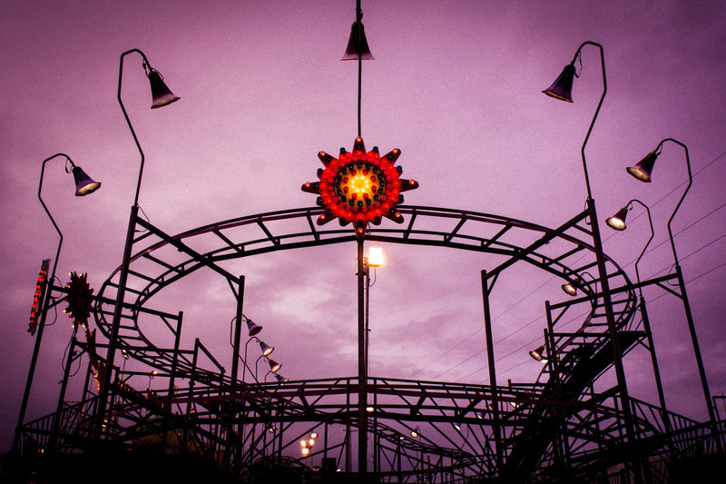 The Amusement Park A New Perspective On Life Illuminated Purple Lighting Equipment Sky Architecture Built Structure Ferris Wheel Amusement Park Ride Rollercoaster Amusement Park Ride Fairground Ride